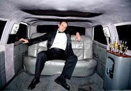 man sitting in a limousine
